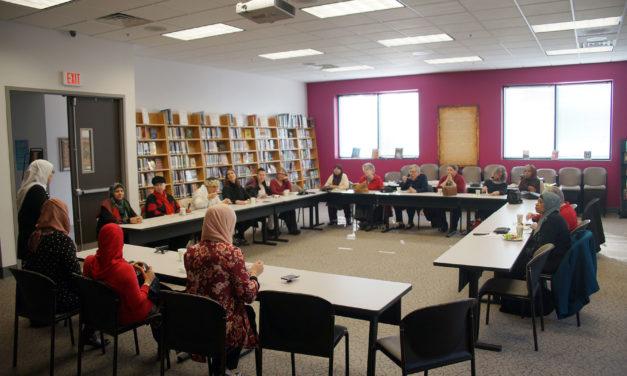 Umrah pilgrims discuss trip with interfaith group