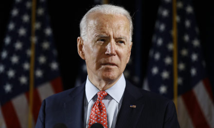 Top Muslim political group backs Biden